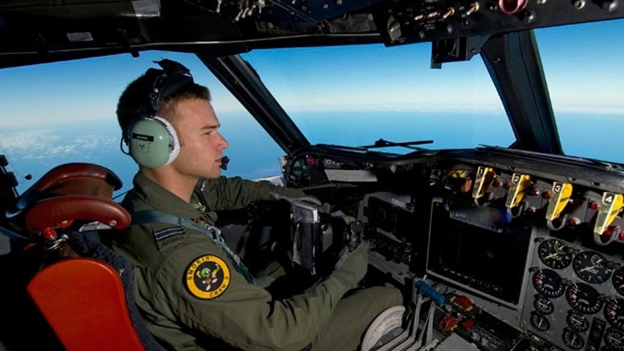March 20, 2014 : Royal Australian Air Force pilot Flight Lieutenant Russell Adams steers his AP-3C Orion over the Southern Indian Ocean during the search for missing Malaysian Airlines flight MH370.