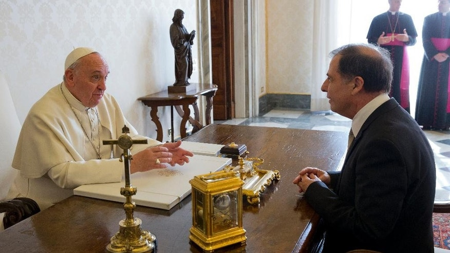 Pope Francis talks with Malta's President George Abela during a private audience in the Pontiff's studio, at the Vatican, Friday, March 21, 2014. (AP Photo/Andrew Medichini, Pool)