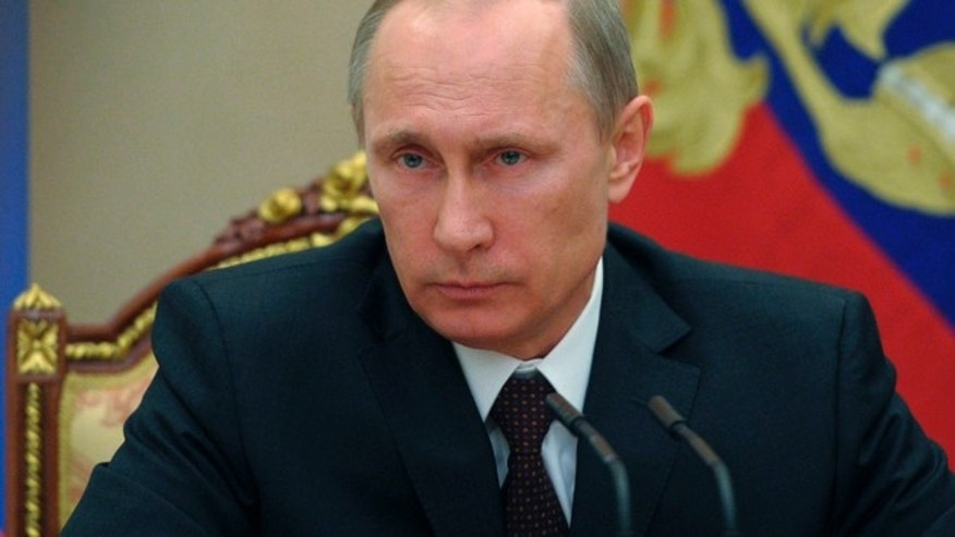 "March 21: Vladimir Putin hailed the incorporation of Crimea into Russia as a ""remarkable event"" before he signed the bills into law in the Kremlin."