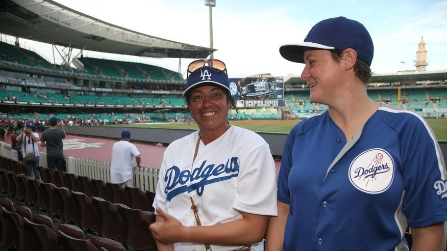 Narelle Walton, right, and her fridend Mereana Joseph arrive at the Sydney Cricket Ground where the Major League Baseball opening game between the Los Angeles Dodgers and Arizona Diamondbacks is scheduled in Sydney, Saturday, March 22, 2014.  (AP Photo/Rick Rycroft)