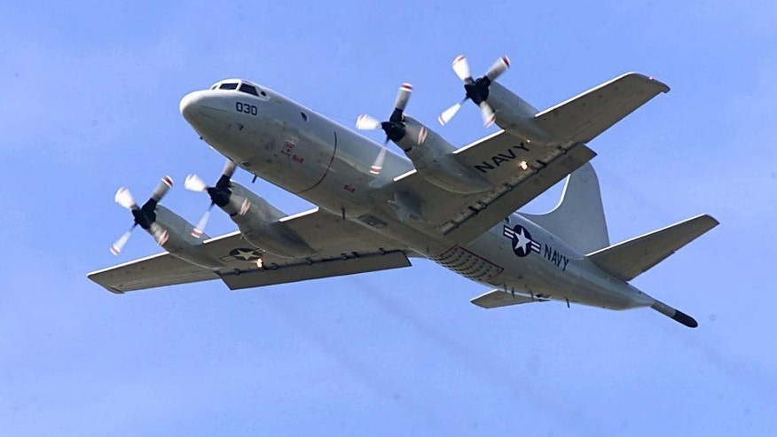 FILE - In this April 4, 2001 file photo, P-3C Orion practices touch-and-go landings at Whidbey Island Naval Air Station near Oak Harbor, Wash. The similar type of the P-3 Orion, favored by the Australian and New Zealand defense forces, is used in the search for the Malaysia Airlines Flight 370 which went missing on March 8, 2014, off the west coast of Australia. Because the search area is so remote, it's an eight-hour round trip, leaving the planes just two or three hours to search. (AP Photo/Stevan Morgain, File)