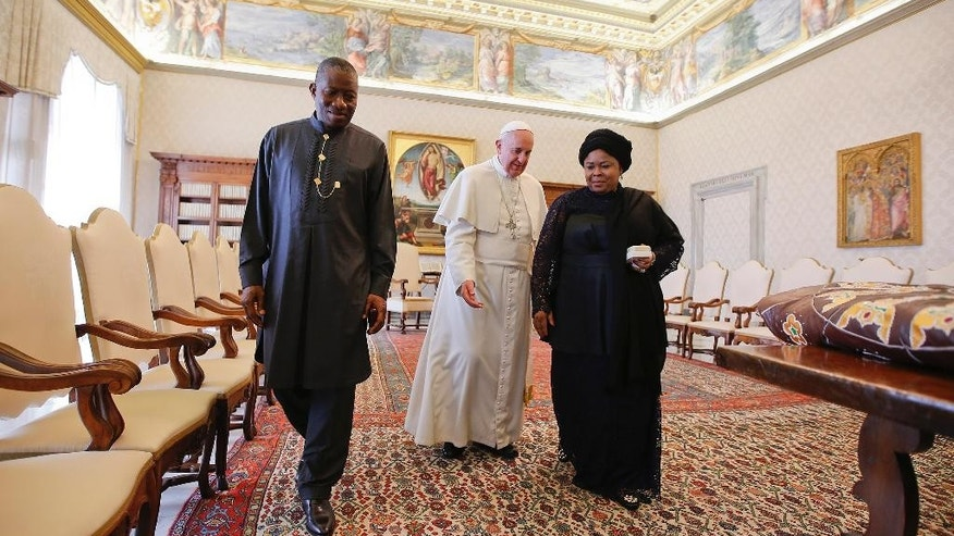 Pope Francis leaves at the end of a private audience with Nigerian President Goodluck Jonathan, left, and his wife Patience, at the Vatican, Saturday, March 22, 2014. (AP Photo/Tony Gentile, Pool)