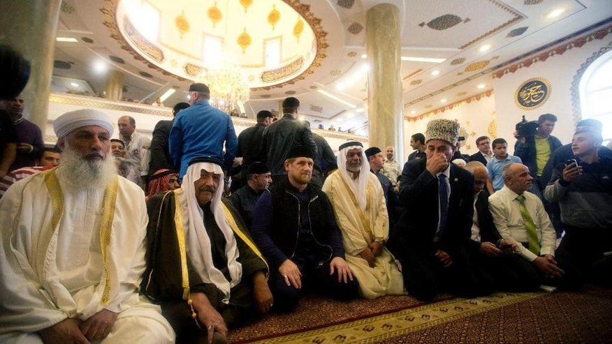 Chechen President Ramzan Kadyrov, center, prays inside a new mosque in the Arab village of Abu Ghosh, on the outskirts of Jerusalem, Sunday, March 23, 2014. Isa Jabar, the mayor of the village, says Chechnya donated $6 million for the new mosque and that some Abu Ghosh residents trace their ancestry to 16th century Chechnya and the Caucus region. (AP Photo/Sebastian Scheiner)
