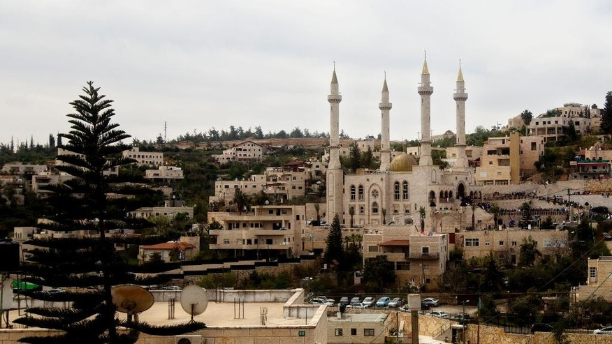 A general view of a new mosque, partially funded by Chechnya, in the Arab village of Abu Ghosh, on the outskirts of Jerusalem, Sunday, March 23, 2014. Isa Jabar, the mayor of the village, says Chechnya donated $6 million for the new mosque and that some Abu Ghosh residents trace their ancestry to 16th century Chechnya and the Caucus region. (AP Photo/Sebastian Scheiner)
