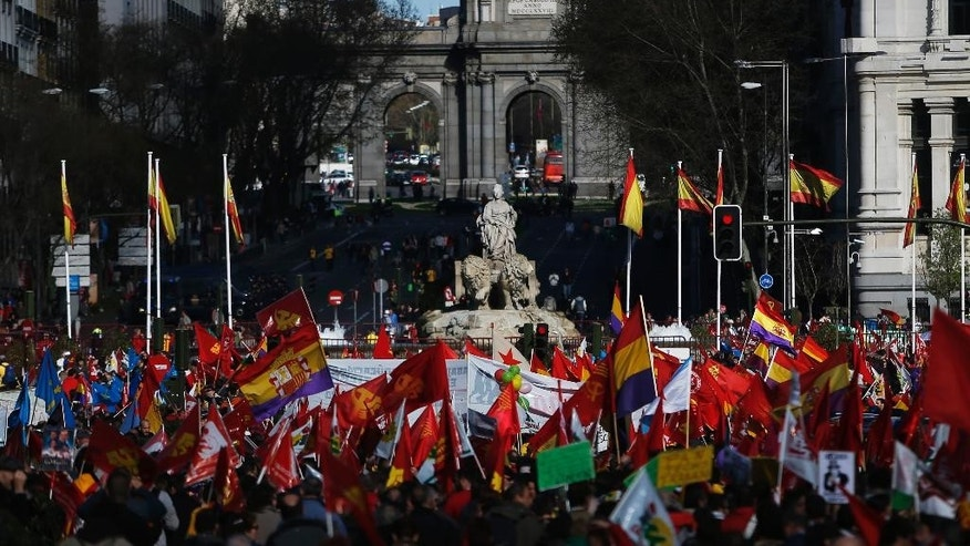 People gather during a protest against the Government  in Madrid, Spain, Saturday, March 22, 2014. Thousands from different parts of Spain marched towards the Capital to join a large anti-austerity demonstration, demanding the resignation of the Government and to express their anger at government financial cuts, its housing rights policies, and the high unemployment rates. (AP Photo/Andres Kudacki)
