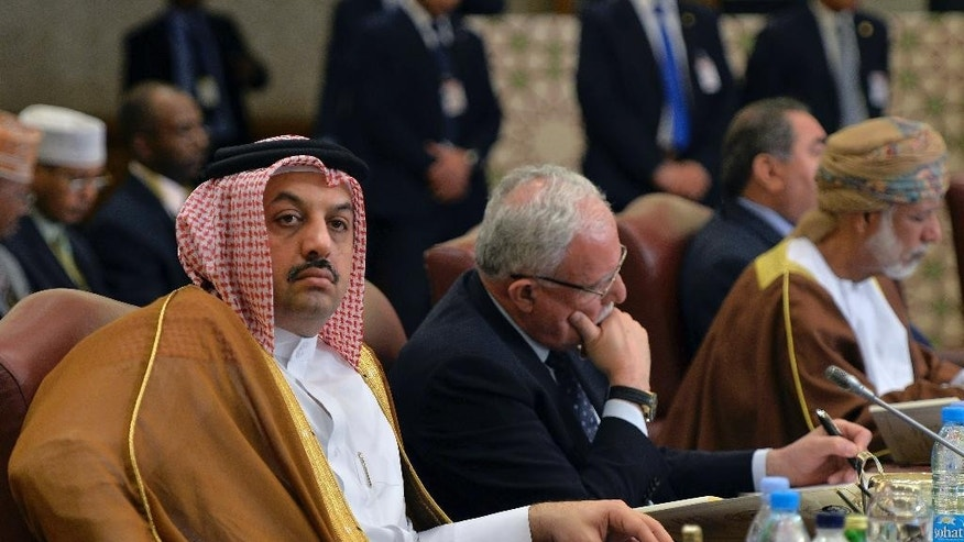 Qatar's Foreign Minister Sheik Khaled al-Attiyah, left, attends a session of Arab Foreign Ministers session in Kuwait City on Sunday, March 23, 2014. The Arab ministers held a preparatory meeting on Sunday prior to the 25th Arab Summit on Tuesday in Kuwait City. (AP Photo/Nasser Waggi)