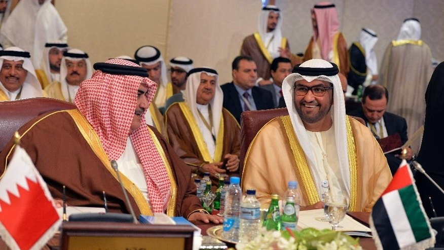 Bahrain's Minister of Foreign Affairs Shaik Khalid bin Ahmed bin Mohammed Al Khalifa, left, talks with his counterpart from the United Arab Emirates, Sheik Abdullah bin Zayed Al Nahyan during an Arab Foreign Ministers session in Kuwait City on Sunday, March 23, 2014. The Arab ministers held a preparatory meeting on Sunday prior to the 25th Arab Summit Tuesday in Kuwait City. (AP Photo/Nasser Waggi)