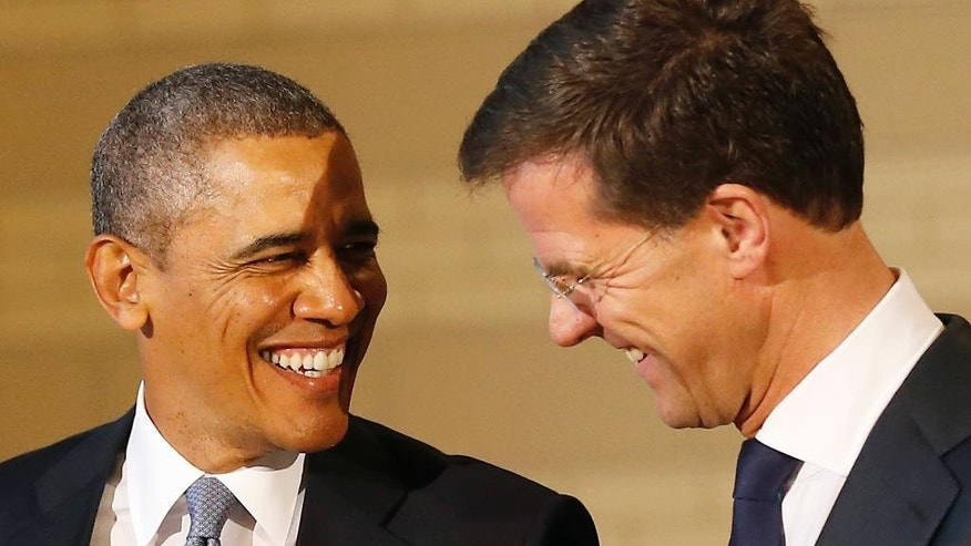 U.S. President Barack Obama, left, shares a laugh with Dutch Prime Minister Mark Rutte, right, during a visit to the Rijksmuseum in Amsterdam, Netherlands, Monday, March 24, 2014. Obama will attend the two-day Nuclear Security Summit in The Hague. (AP Photo/Frank Augstein)
