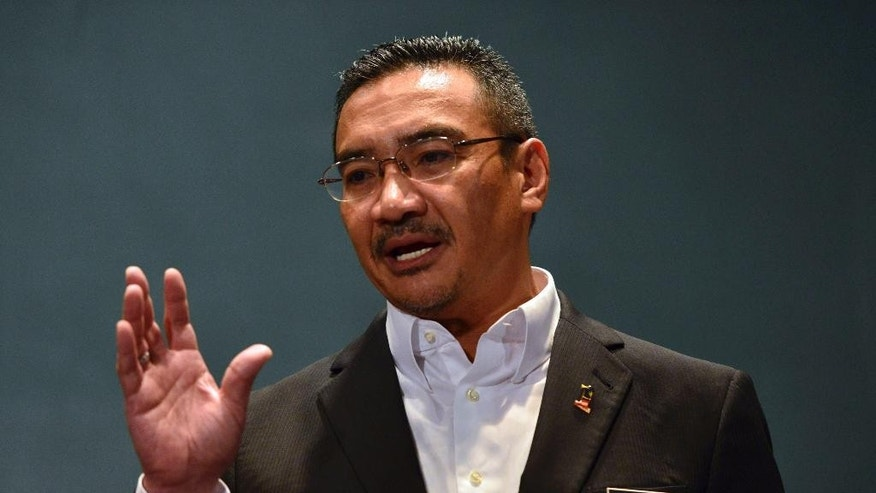 FILE - In this Monday, March 10, 2014 file photo, Malaysian acting Transport Minister Hishammuddin Hussein speaks during a press conference at a hotel in Sepang, Malaysia. Hishammuddin Hussein's wife is a princess. His cousin is prime minister, and he's been mentioned as a possible successor. But right now, as the face of his country's effort to find Malaysia Airlines Flight 370, he is the man who has delivered more than two weeks of frustrating news about one of the most confounding searches in aviation history. (AP Photo)