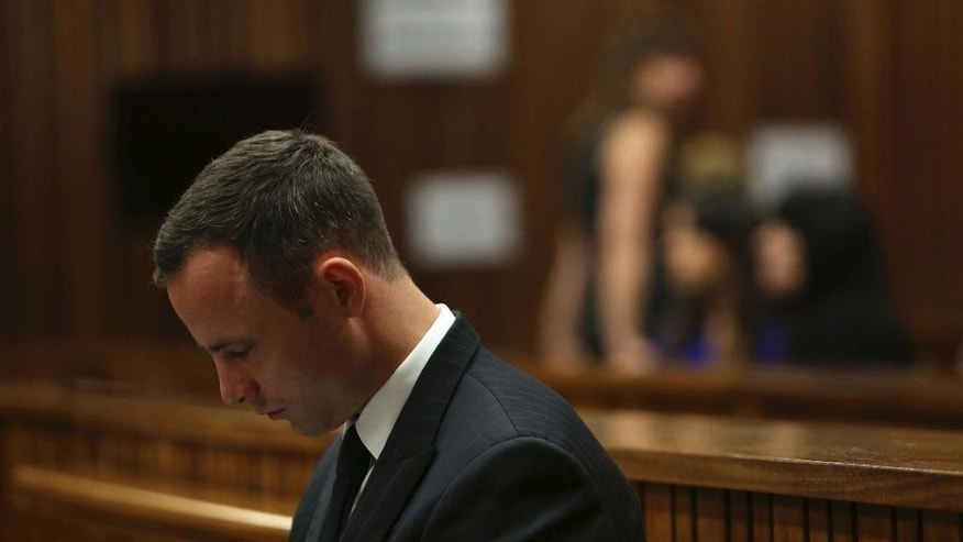 Oscar Pistorius sits in the dock in court of his murder trial in Pretoria, South Africa, Tuesday, March 25, 2014. Pistorius is charged with the Valentines Day 2013 shooting death of his girlfriend Reeva Steenkamp. (AP Photo/Esa Alexander, Pool)