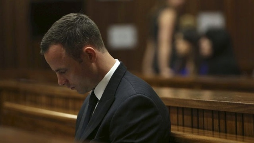 March 25, 2014: Oscar Pistorius sits in the dock in court of his murder trial in Pretoria, South Africa. Pistorius is charged with the Valentine's Day 2013 shooting death of his girlfriend Reeva Steenkamp. (AP Photo/Esa Alexander, Pool)