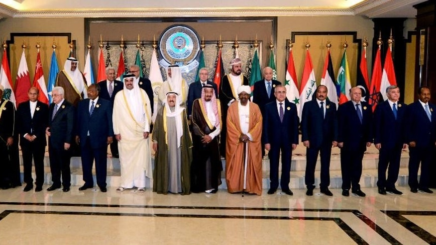 Arab leaders pose for a group photograph during the opening session of the Arab League Summit in Bayan Palace, Kuwait City, Tuesday, March 25, 2014. (AP Photo/Nasser Waggi)
