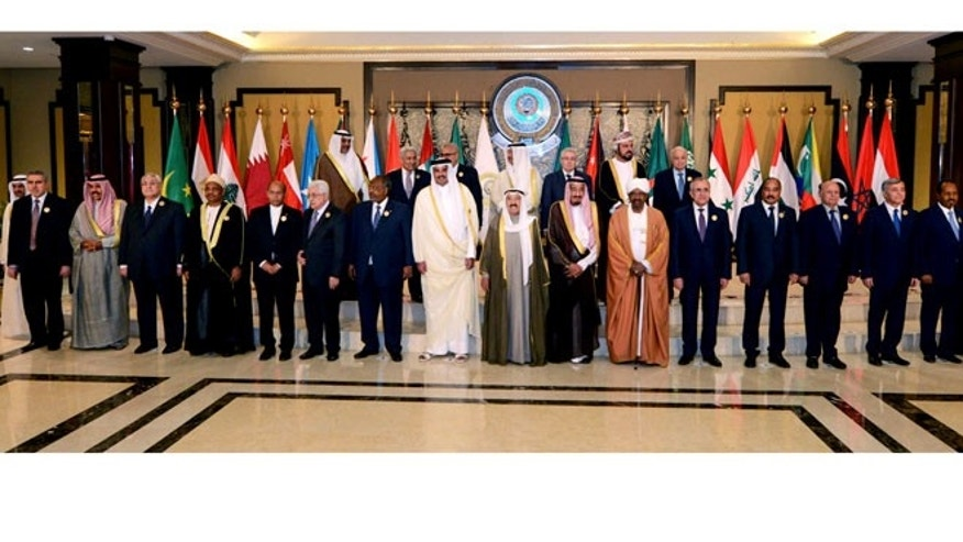 March 25, 2014: Arab leaders pose for a group photograph during the opening session of the Arab League Summit in Bayan Palace, Kuwait City.