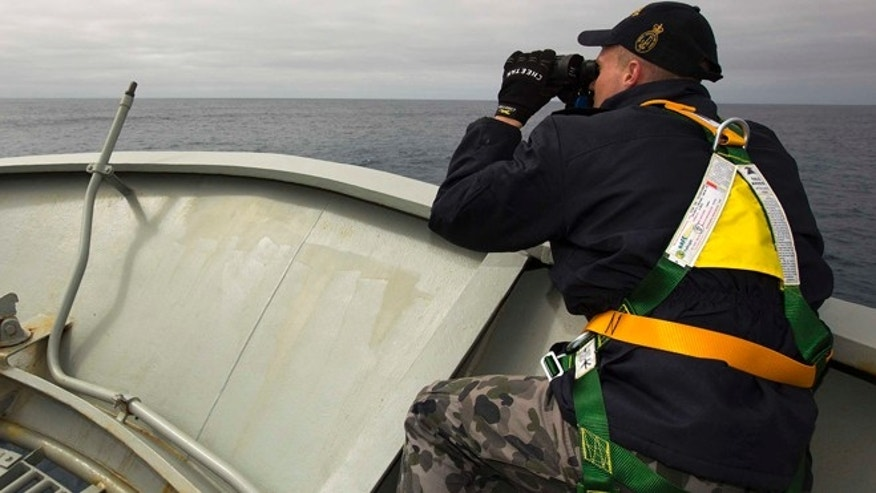 March 22, 2014: In this photo provided by the Australian Department of Defence (ADF), a lookout is stationed on bow of HMAS Success during the search in the southern Indian Ocean for signs of the missing Malaysia Airlines Flight MH370.