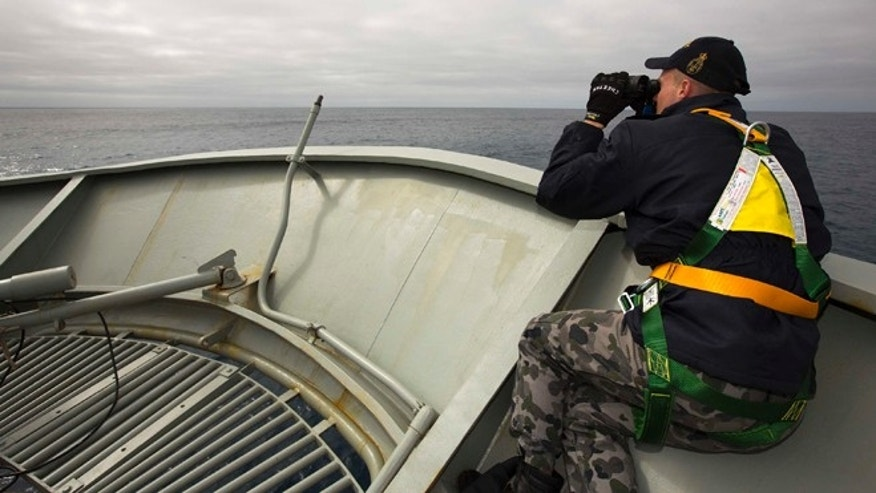 In this March 22, 2014 photo provided by the Australian Department of Defence (ADF), a lookout is stationed on bow of HMAS Success during the search in the southern Indian Ocean for signs of the missing Malaysia Airlines Flight MH370. The desperate, multinational hunt for Flight 370 resumed again Wednesday, March 26 across a remote stretch of the Indian Ocean after fierce winds and high waves that had forced a daylong halt eased considerably. (AP Photo/ADF, James Whittle) EDITORIAL USE ONLY