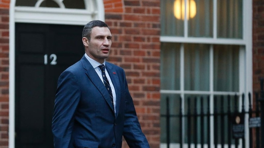 Ukrainian parliamentarian Vitali Klitschko, leader of the UDAR (Ukrainian Democratic Alliance for Reform) party, arrives at 10 Downing Street for a meeting with British Prime Minister David Cameron and British Foreign Secretary William Hague, London, Wednesday, March 26, 2014. (AP Photo/Sang Tan)