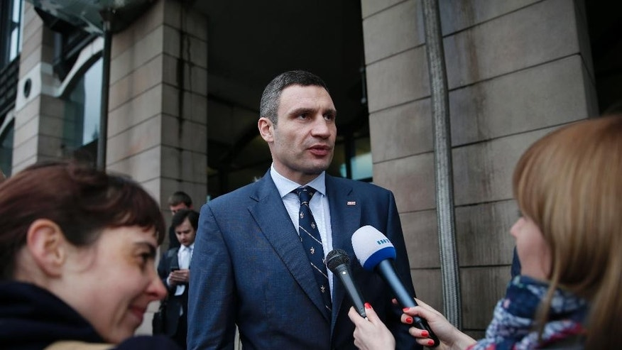 Vitali Klitschko, leader of Ukraine's UDAR party, talks to members of the media after meetings with British parliamentarians in central London, Wednesday, March 26, 2014. (AP Photo/Lefteris Pitarakis)