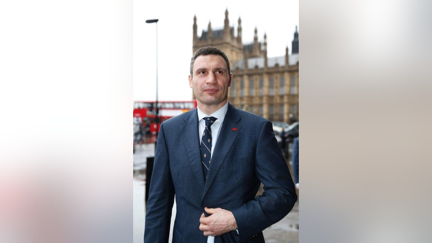 Vitali Klitschko, leader of Ukraine's UDAR party, poses for the photographers after meetings with British parliamentarians in central London, Wednesday, March 26, 2014. (AP Photo/Lefteris Pitarakis)