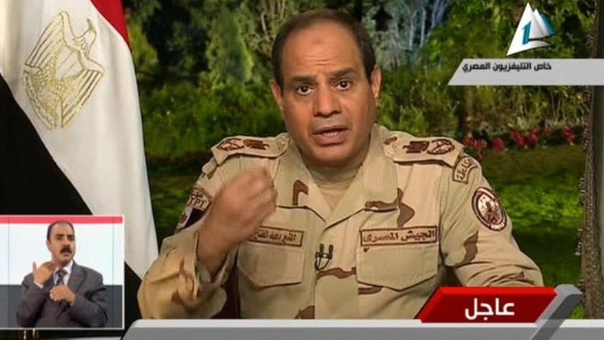 March 26, 2014: In this image made from video broadcast on Egypt's State Television, Egypt's military chief Abdel-Fattah el-Sissi speaks in a nationally televised speech, announcing that he will run for president, in Cairo, Egypt.