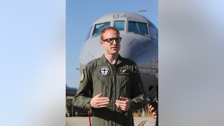 "Royal New Zealand Air force Flight Lt. Stephen Graham explains the workings of the P-3C Orion while the crew has a rest day from searching for the missing Malaysia Airlines Flight MH370 in Perth, Australia, Thursday, March 27, 2014. ""It is incredibly fatiguing work,"" said Graham, tactical coordinator for the crew on board a Royal New Zealand Air Force P-3 Orion that has made six sorties into the southern Indian Ocean search zone. ""If it's bright and glaring obviously sunglasses help, but there's only so much you can do."" (AP Photo/Rob Griffith)"
