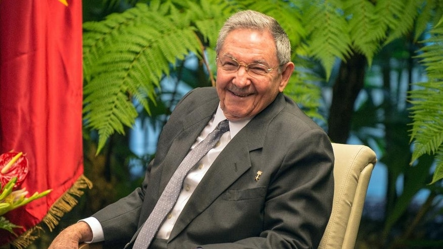 Cuba's President Raul Castro, smiles during a meeting with Vietnam's Prime Minister Nguyen Tan Dung, not seen, at Revolution Palace in Havana, Cuba, Thursday, March. 27, 2014. Tan Dung is in Cuba in a three-day official visit. (AP Photo/Adalberto Roque, Pool)