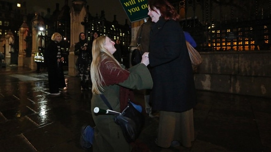 Feb. 5: Elizabeth Maddison proposes marriage to her civil partner Hannah Pearson in front of Parliament in London.