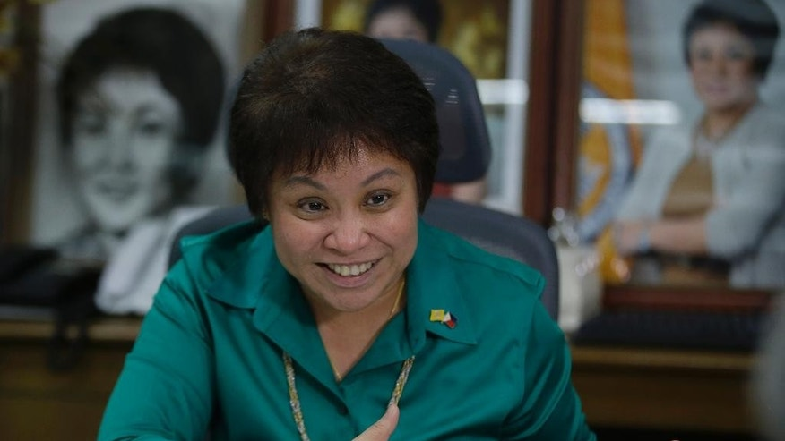 In this Feb. 4, 2014 photo, Bureau of Internal Revenue Commissioner Kim Henares speaks during an interview at her office at suburban Quezon city, northeast of Manila, Philippines. The petite sharp-shooting bureaucrat in charge of getting Filipinos to pay their fair share of taxes couldn't have chosen a higher profile target: Manny Pacquiao, the world champion boxer and hero to millions. Henares has remained steadfast in her campaign against the boxer, who also was listed as the country's wealthiest member of Congress last year. The Philippines posted 7.2 percent growth in gross domestic product last year, the second highest in Asia after China, but government revenue has fallen short of expectations in a country where decades of corrupt and inefficient government allowed a culture of tax evasion to flourish. (AP Photo/Bullit Marquez)