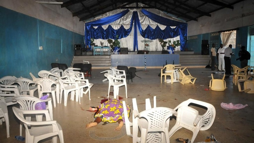 The body  of the a worshipper lies on the floor inside Kenyan Joyland church in Likoni,  near Mombasa, Kenya Sunday, March 23, 2014. Kenyan officials said  three people died after gunmen opened fire in a church just outside the coastal city of Mombasa. The Interior Ministry said Sunday that three gunmen opened fire inside the Joyland Church killing a small number of  people. At least 10  were wounded.  (AP Photo)