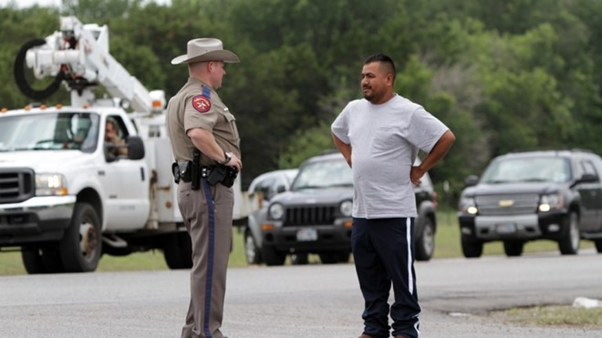 Pablo Ramirez, 33, right, speaks to a Texas state trooper on May 16, 2013 in Granbury, Texas.