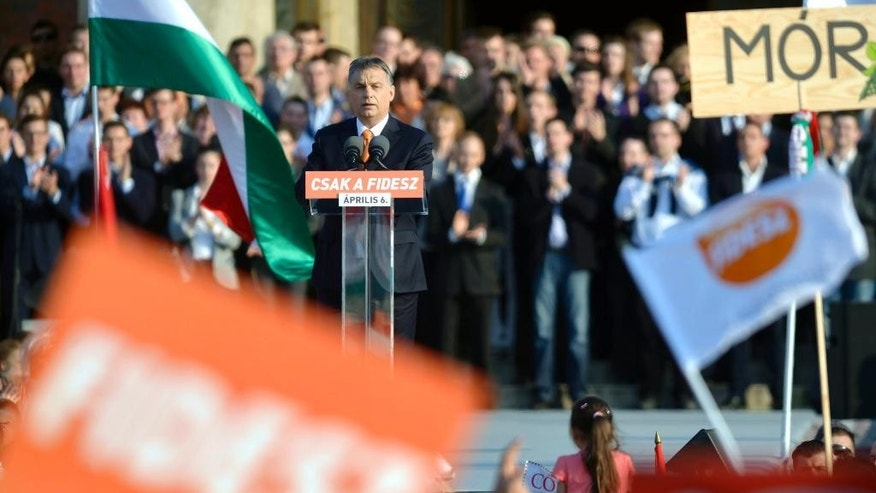 "Hungarian Prime Minister and Chairman of ruling centre right Fidesz party Viktor Orban addresses the election rally of Fidesz and its coalition ally Christian Democratic People's Party in Heroes' Square in Budapest, Hungary, Saturday, March 29, 2014. Inscription reads: ""Fidesz only"". The parliamentary elections are held on April 6, 2014 in Hungary. (AP Photo/MTI, Laszlo Beliczay)"