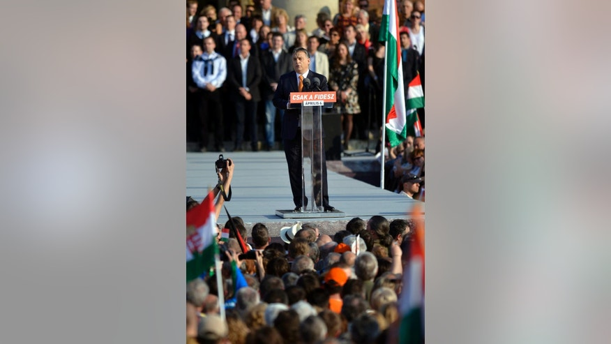 "Hungarian Prime Minister and Chairman of ruling center right Fidesz party Viktor Orban addresses the election rally of Fidesz and its coalition ally Christian Democratic People's Party in Heroes' Square in Budapest, Hungary, Saturday, March 29, 2014. Inscription reads: ""Fidesz only"". The parliamentary elections are held on April 6, 2014 in Hungary. (AP Photo/MTI, Laszlo Beliczay)"