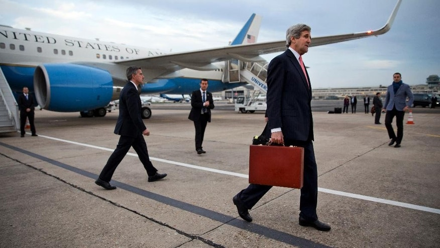 U.S. Secretary of State John Kerry arrives in Paris, on Saturday March 29, 2014. After leaving Saudi Arabia the secretary canceled a return to Washington in order to travel to Paris for a meeting with Russian Foreign Minister Sergey Lavrov about the situation in Ukraine. The meeting was arranged during a refueling stop in Ireland en route to Paris. (AP Photo/Jacquelyn Martin, Pool)