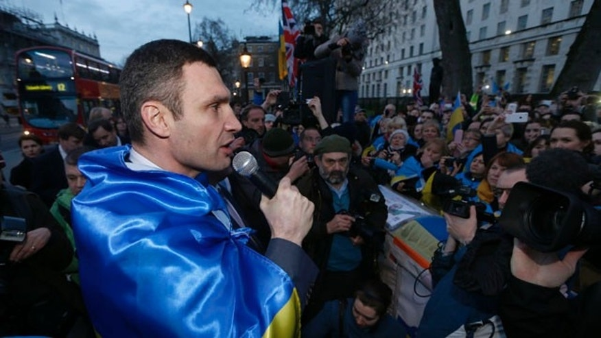 March 26, 2014: Vitali Klitschko, leader of the UDAR (Ukrainian Democratic Alliance for Reform) party, addresses protesters outside 10 Downing Street in London after a meeting with British Prime Minister David Cameron and Foreign Secretary William Hague. (AP Photo/Sang Tan)