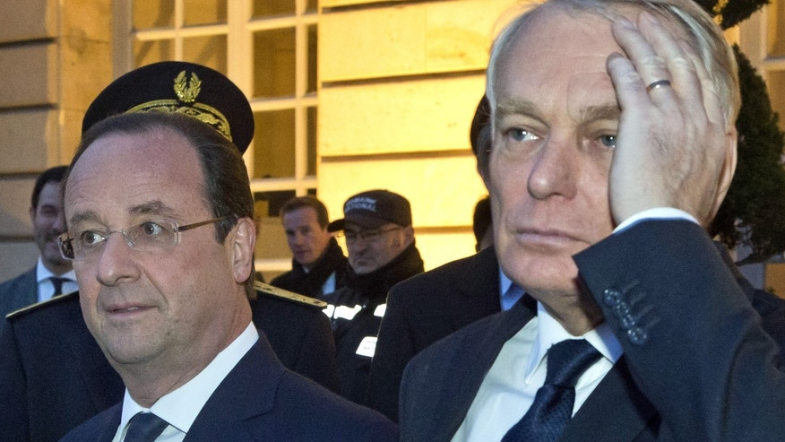 March 27, 2014 - FILE photo- French President Francois Hollande, left, and French Prime Minister Jean-Marc Ayrault, right, at the Chateau de Versailles, west of Paris.