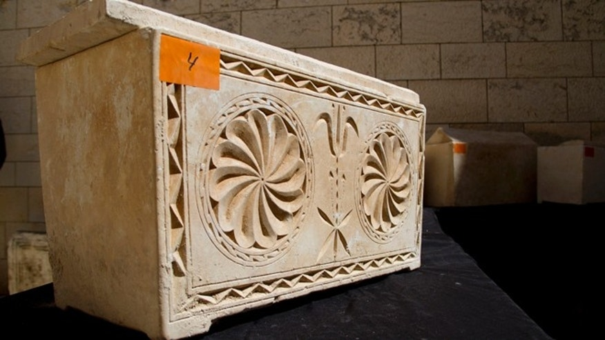 March 31, 2014: A 2,000 year-old Jewish burial box is on display in Jerusalem.
