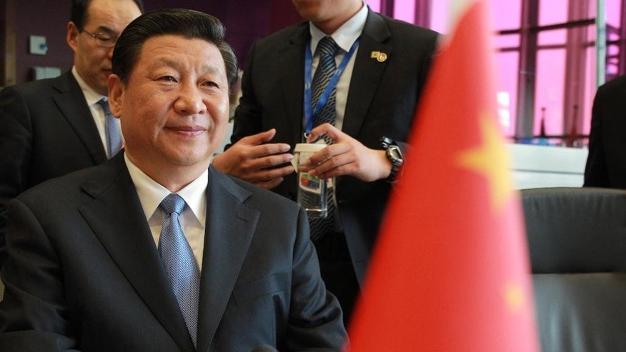China's President Xi Jinping attends a meeting at the European Commission headquarters in Brussels, Monday, March 31, 2014. China's President Xi Jinping is on a three-day visit to meet Belgian and EU officials. (AP Photo/Yves Logghe, pool)