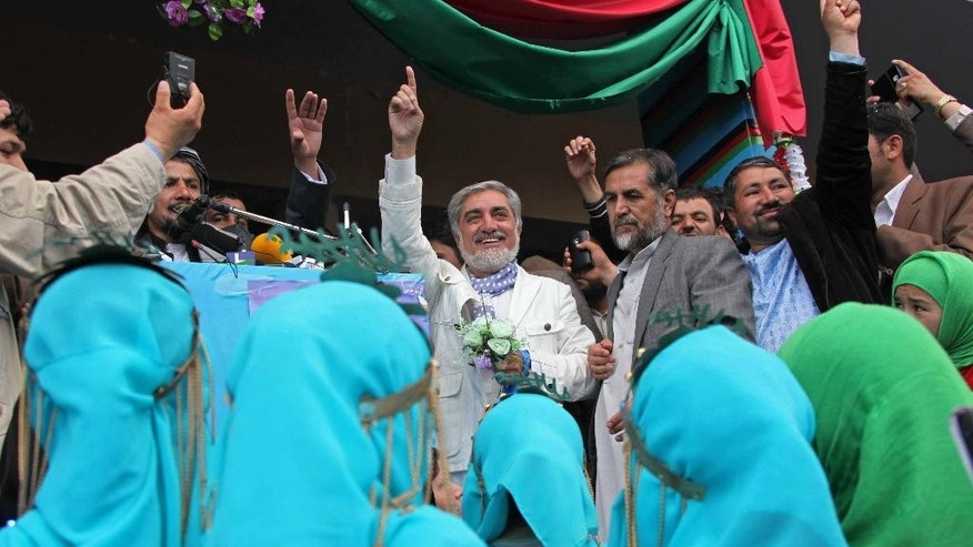 Afghan presidential candidate Abdullah Abdullah arrives for a campaign rally in Herat, Afghanistan, Tuesday, April 1, 2014. Eight Afghan presidential candidates are campaigning for the third presidential election. Elections will take place on April 5, 2014. (AP Photo/Hoshang Hashimi)