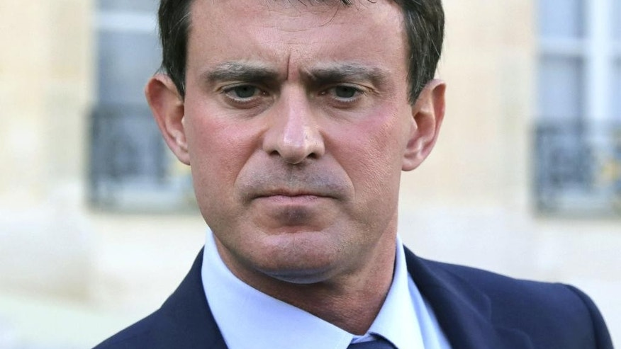 "FILE - In this Oct. 23, 2013 file photo French Interior Minister, Manuel Valls pauses as he speaks to the media at the Elysee Palace in Paris. France's president has named 51-year-old Socialist Manuel Valls as the country's new prime minister, it was announced, Monday, March 31, 2014. In a prerecorded televised speech, Francois Hollande said Valls, the former interior minister, would lead a ""combative government."" (AP Photo/Michel Euler, File)"