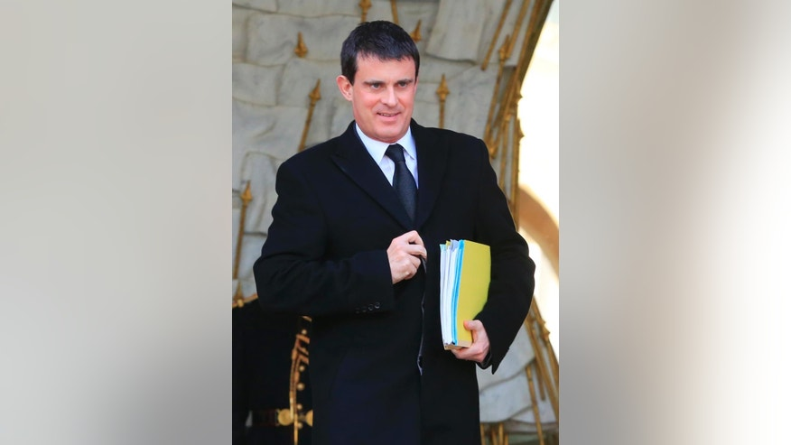 "FILE - In this Jan. 8, 2014 file photo, French Interior Minister Manuel Valls leaves the Elysee Palace after the weekly cabinet meeting, in Paris.  France's president has named 51-year-old Socialist Manuel Valls as the country's new prime minister, it was announced, Monday, March 31, 2014. In a prerecorded televised speech, Francois Hollande said Valls, the former interior minister, would lead a ""combative government."" (AP Photo/Jacques Brinon, File)"