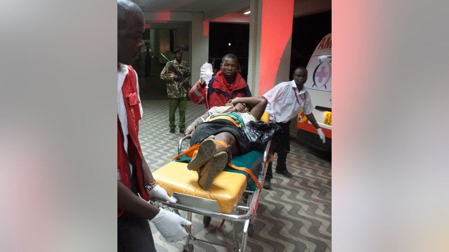 An injured Kenyan is wheeled into Kenyatta National Hospital in Nairobi, Kenya, Monday March 31, 2014, after an explosion in Nairobi killed at least five people. The National Disaster Operation Center said on Twitter that explosions had occurred Monday evening in a neighborhood known for its large Somali population, and the agency said five people were killed and several injured without saying what caused the blasts. (AP Photo/Sayyid Azim)