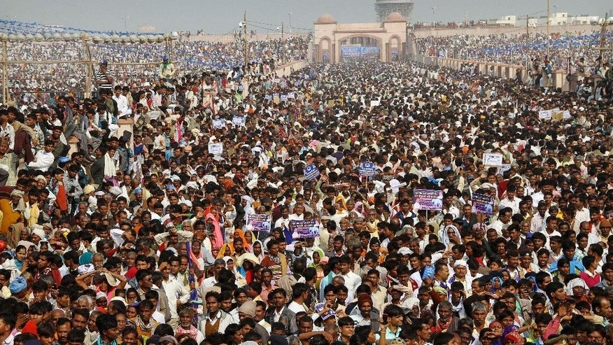 "FILE - In this Nov. 27, 2011 file photo, supporters mainly belonging to India's lower castes listen to Uttar Pradesh state Chief Minister and leader of the Bahujan Samaj Party (BSP) Mayawati as she addresses a rally in Lucknow, India. Although India's constitution and laws forbid discrimination on the basis of caste, the millennia-old social division continues to dominate electoral politics. The former ""untouchables"" or Dalits are a powerful vote bank and political parties make all manner of promises to woo them. (AP Photo/File)"