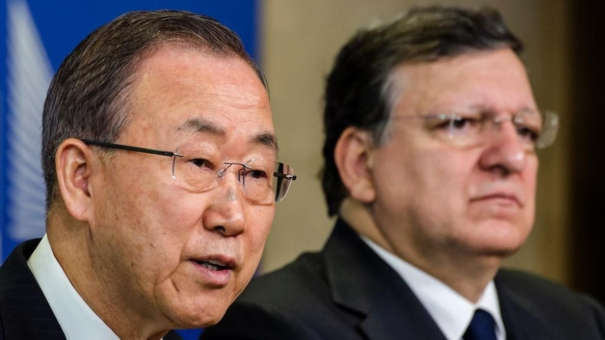 European Commission President Jose Manuel Barroso, right, and United Nations Secretary General Ban Ki-moon address the media after a meeting at the European Commission headquarters in Brussels on Wednesday, April 2, 2014. (AP Photo/Geert Vanden Wijngaert)