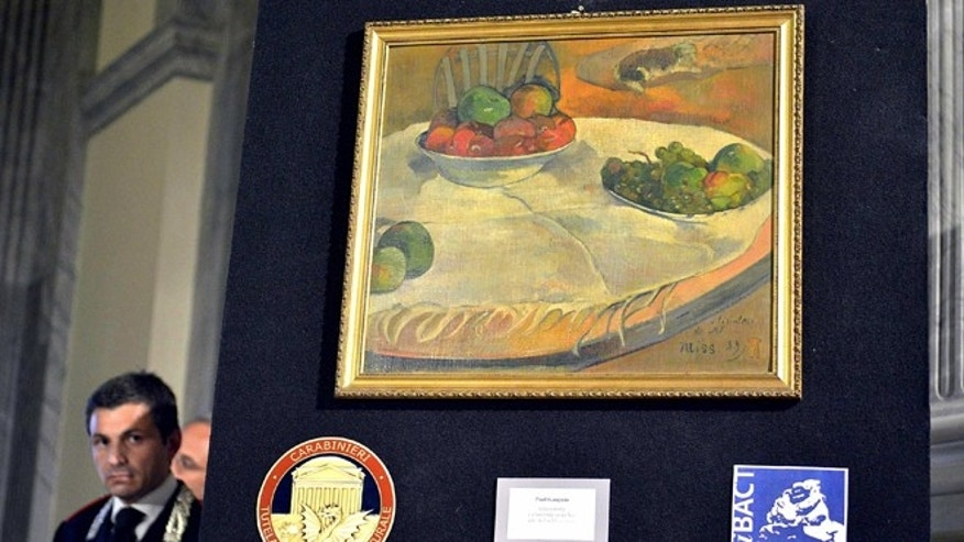 April 2, 2014: A Paul Gauguin still life recovered by authorities is shown during a press conference in Rome.