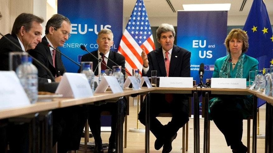 U.S. Special Envoy Carlos Pascual, left, U.S. Ambassador to the European Union Anthony Gardner, and U.S. Department of Energy Deputy Secretary Dan Poneman, listen as U.S. Secretary of State John Kerry, second from right, speaks next to European Union High Representative Catherine Ashton, right, at the start of a U.S.-EU Energy Dialogue meeting at the headquarters of the European Union in Brussels Wednesday April 2, 2014. (AP Photo/Jacquelyn Martin, Pool)