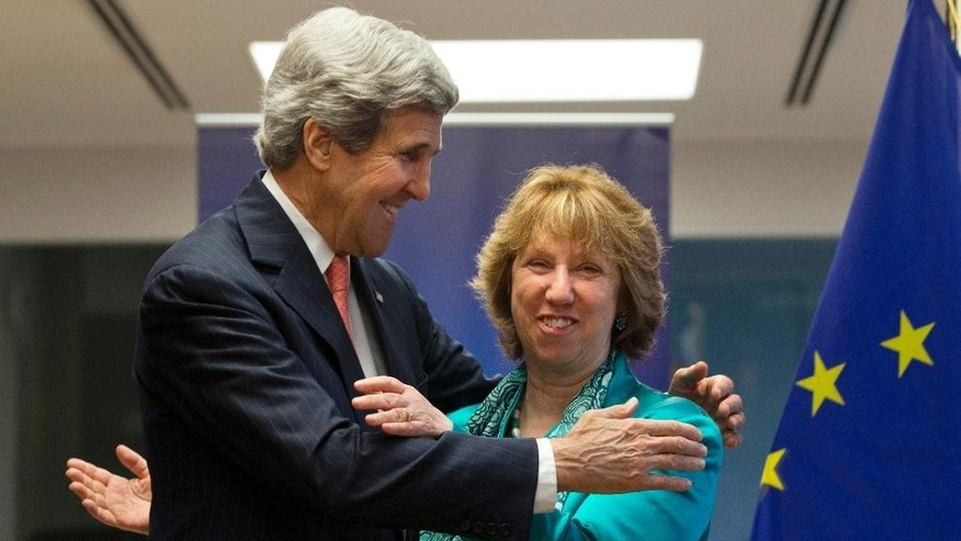 U.S. Secretary of State John Kerry, left, hugs European Union High Representative Catherine Ashton at the start of a US-EU Energy Dialogue meeting at the headquarters of the European Union in Brussels Wednesday April 2, 2014. (AP Photo/Jacquelyn Martin, Pool)