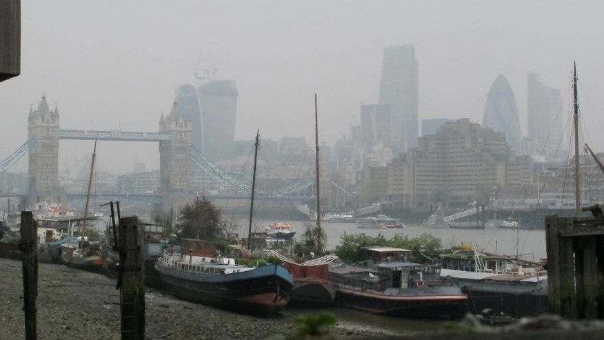 April 3, 2014: Tower Bridge and the high rise towers of the City of London are shrouded in smog.
