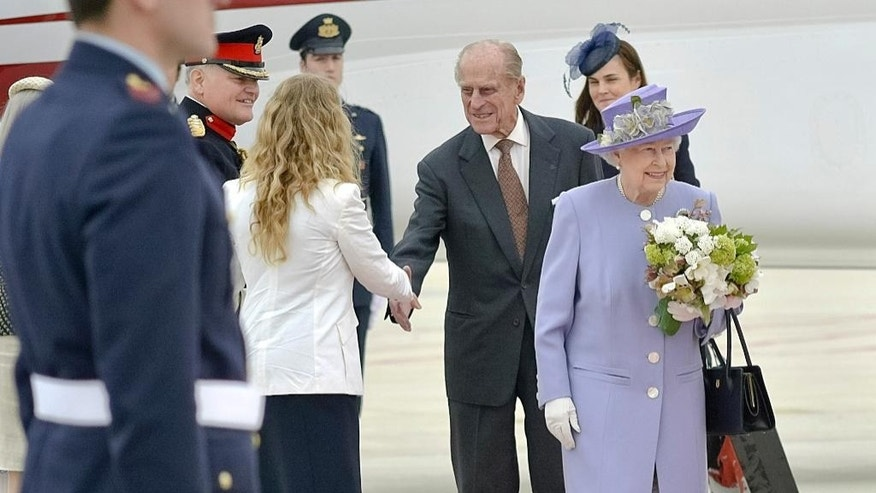 April 3, 2014: Queen Elizabeth II, accompanied by Prince Philip arrives at Rome's Ciampino military airport to start their one-day visit to Italy and the Vatican.
