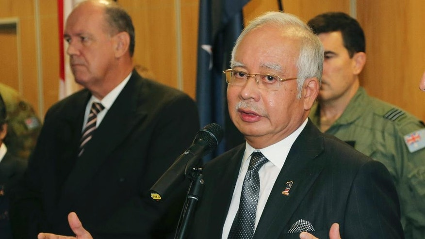 "Malaysian Prime Minister Najib Razak speaks at a breakfast with crew members from different countries involved in the search for wreckage and debris of the missing Malaysia Airlines MH370 in Perth, Australia, Thursday, April 3, 2014. In a hastily called speech, Malaysian Prime Minister Najib Razak announced that an unprecedented analysis of satellite signals concluded that Malaysia Airlines Flight 370 ""ended"" deep in the Indian Ocean, far from any possible refuge for the 239 souls aboard. (AP Photo/Rob Griffith, Pool)"