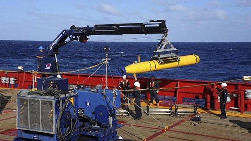The Bluefin 21, the Artemis autonomous underwater vehicle (AUV), is hoisted back on board the Australian navy's Ocean Shield in the southern Indian Ocean. (U.S. Navy)