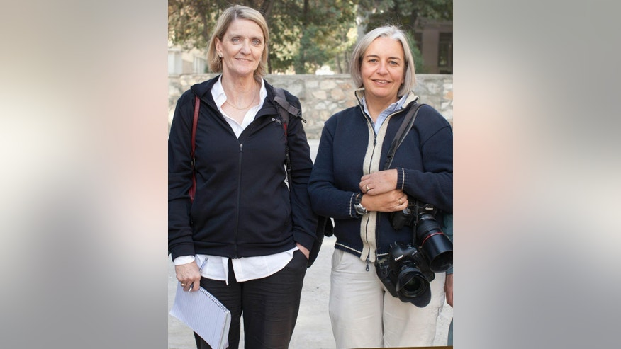 This 2012 photo shows Kathy Gannon, left, Associated Press special correspondent for Afghanistan and Pakistan, and AP photographer Anja Niedringhaus in Afghanistan. An Afghan police commander opened fire Friday, April 4, 2014 on the two journalists inside a security forces base in eastern Afghanistan, killing Niedringhaus and wounding Gannon. (AP Photo)